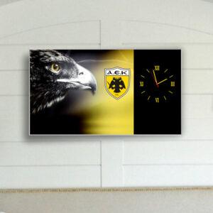 Ρολόι τοίχου 90εκ. x 50εκ. με τεχνολογία ψηφιακής εκτύπωσης σε κορνίζα αλουμινίου και μηχανισμό ρολογιού ακριβείας ομάδα ΑΕΚ